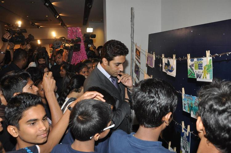 Abhishek With Childrens At Art Exhibition Of Radhika Goenka