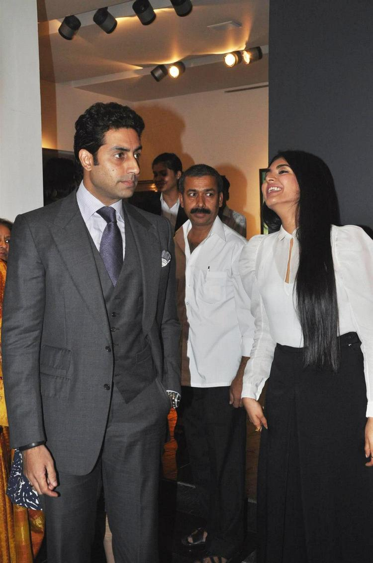 Abhishek Smiling Photo Clicked And Radhika At Art Exhibition Of Radhika Goenka