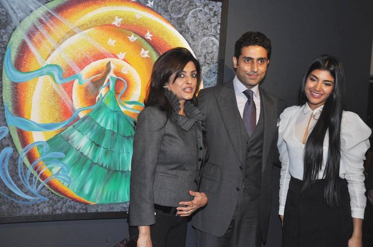 Abhishek,Chaya And Radhika Smiling Pose For Camera At Art Exhibition Of Radhika Goenka