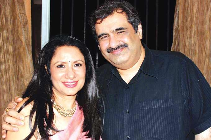 Anu With Hubby Manish Cosy Pose For Camera At A Wedding Anniversary Party