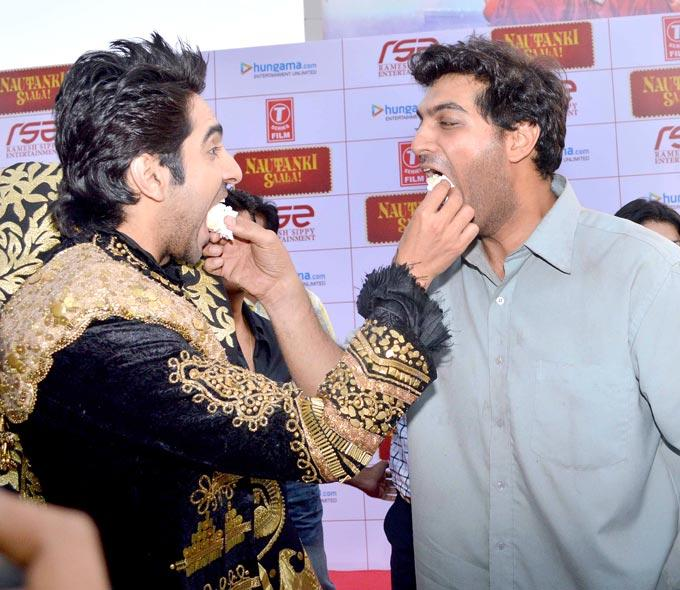 Ayushmann And Kunaal Feed Each Other A Piece Of Cake At First Look Launch Of Nautanki Saala