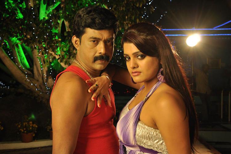 Tashu And A New Hero Spicy Pose Photo From Movie Mahha Raja Sri Gaaligadu