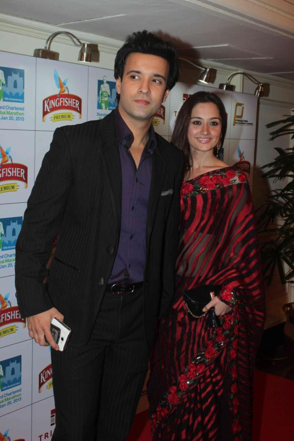 Aamir And Sanjeeda Strike A Pose At Kingfisher Premium Celebrate Pre Marathon Party