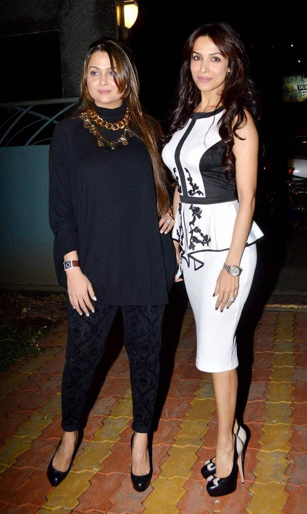 Sisters Amrita And Malaika Gorgeous look photo clicked At A Book Launch