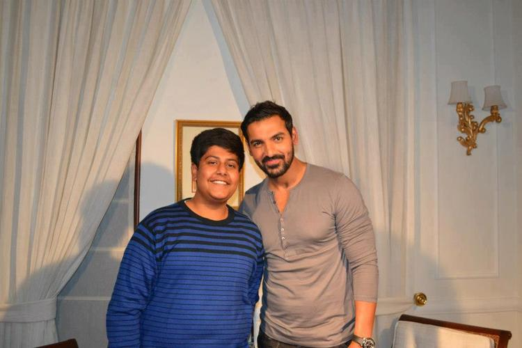 John Abraham With A Fan Posed For Photo