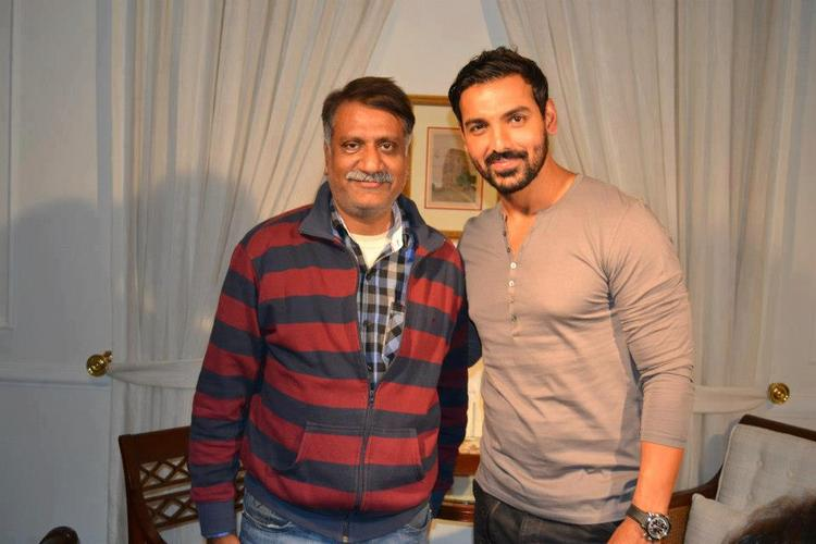 John Abraham Smiling Photo Still With A Fan