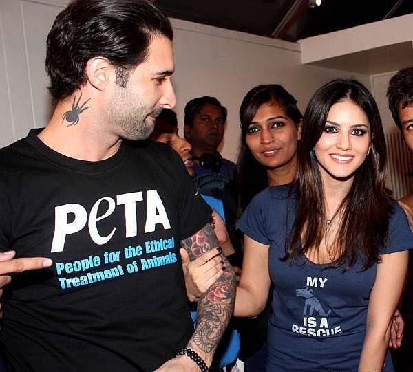 Dino Morea And Sunny Leone Attend The PETA Adopt Stray Dog Event