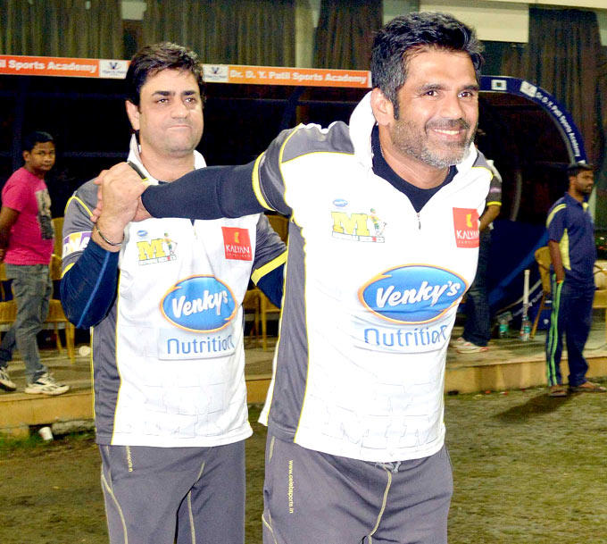 Skipper Suniel Shetty Does Some Stretching With The Help Of Physiotherapist Aijaz Ashai At The DY Patil Sports Academy
