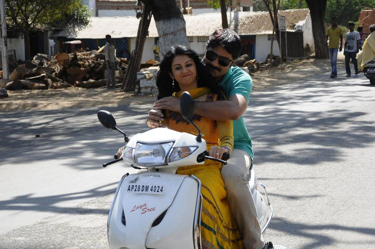 Srikanth And Kamna With A Bike Still From Pushyami Film Makers Movie