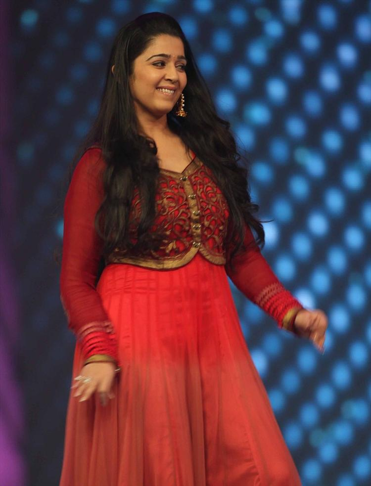 Charmy Kaur Cute Smiling Pose In A Red Dress At CCL 3 Opening Ceremony