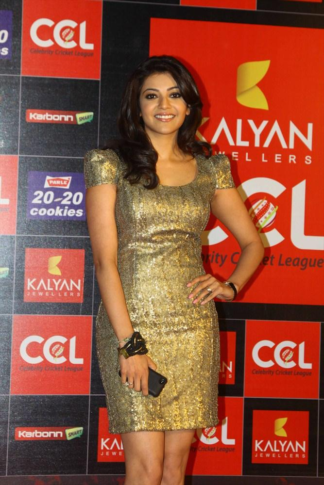 Kajal Posed For Camera In A Chick Golden Mini Dress At CCL 3 Opening Ceremony