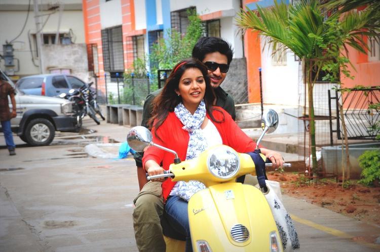 Nikhil And Swati With A Bike Still From Swamy Ra Ra Movie