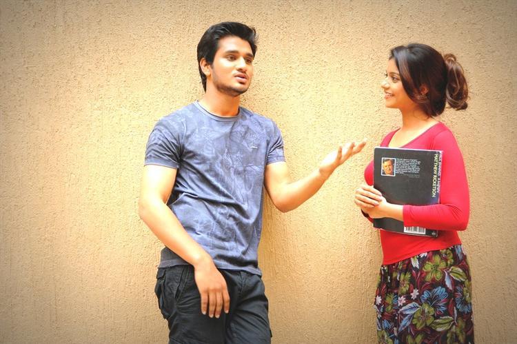 Nikhil And Swati Gossip Still From Swamy Ra Ra Movie