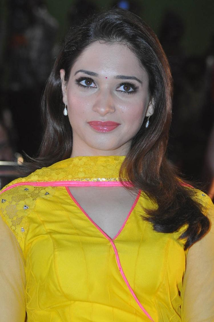 Tamannaah Bhatia In Yellow Dress Glamour Look At Mr Pellikoduku Audio Launch Function