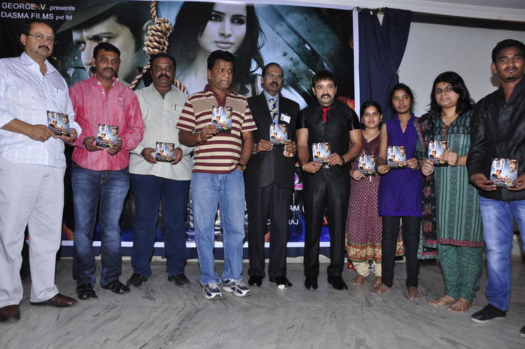 Kiran And Guests With The Audio Disc Posed For Camera At Nisha Audio Launch