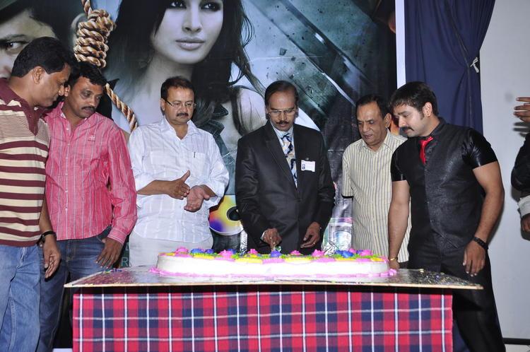 Kiran And Guests Photo Clicked At Cake Cutting