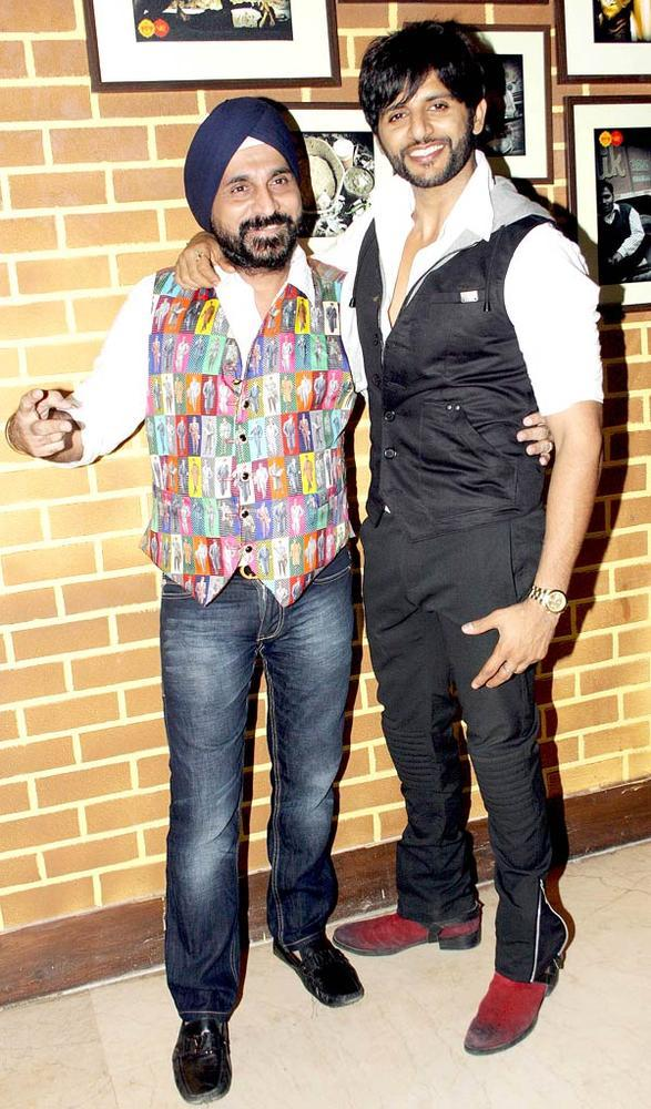Karanvir Bohra Poses With A Guest At The Launch Of Manoj And Teejay Bohra Production House