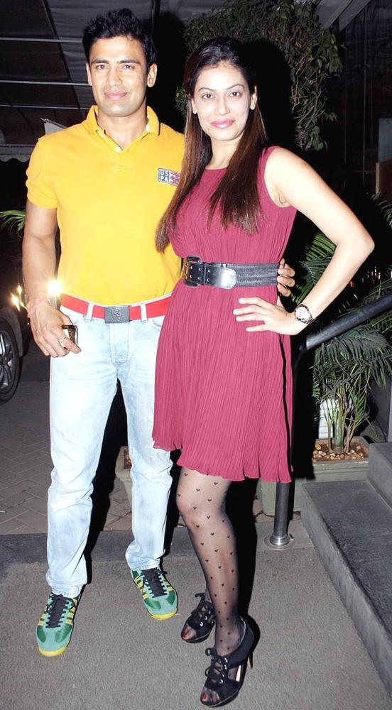 Sangram Singh And Payal Rohatgi Posed At The Launch Of Manoj And Teejay Bohra Production House
