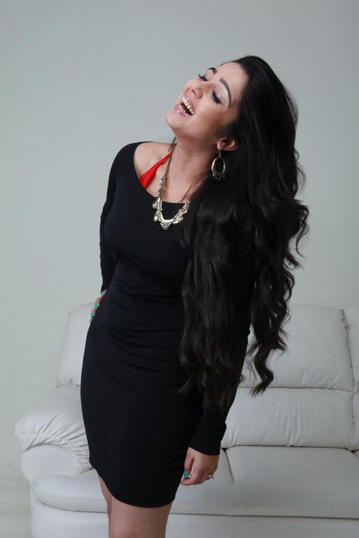 Charmy Kaur In Black Dress Cool Smiling Still From Prema Oka Maikam Movie