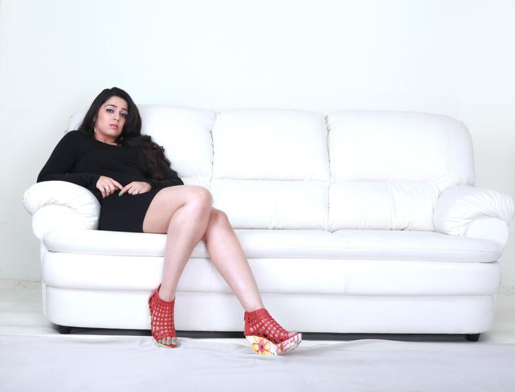 Charmy Kaur In Black Dress Sexy Still From Prema Oka Maikam Movie