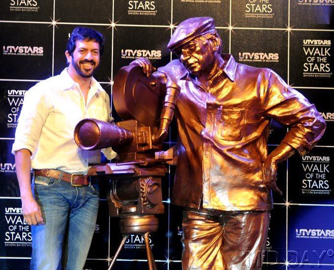 Kabir Khan Poses Alongside Yash Chopra's Statue