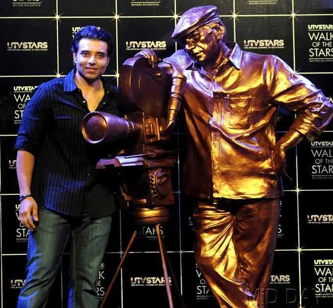 Son Uday Chopra Poses Alongside The Statue Of His Late Father Yash Chopra