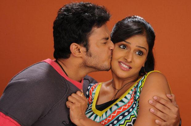 Tanish Alladi Kisses Remya Nabeeshan Hot Look Still From Telugabbai Movie