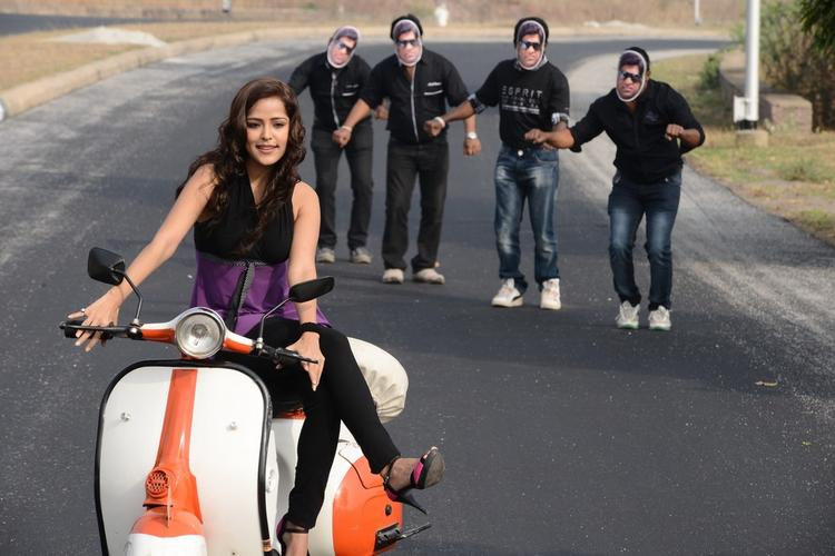 Priyanka Chabra Photo Still On Scooter At Athadu Ame O Scoter Movie Location