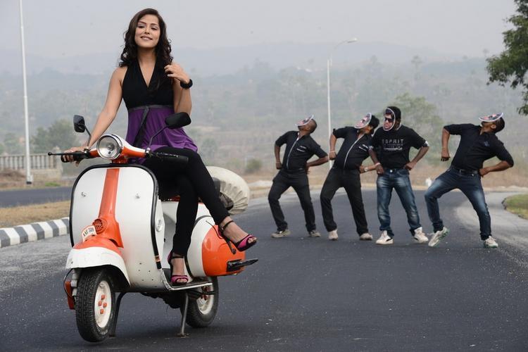 Priyanka Chabra Song Still At Athadu Ame O Scoter Movie Location