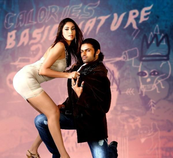 Sai Dharam With Co Actress Sizzling Pose Photo Still From Movie Rey