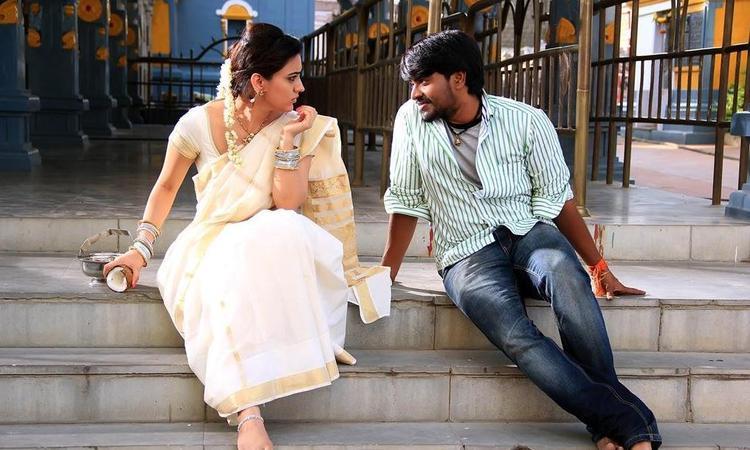 Srinivas And Aksha Sitting Photo Still On Temple Steps In Movie Rye Rye