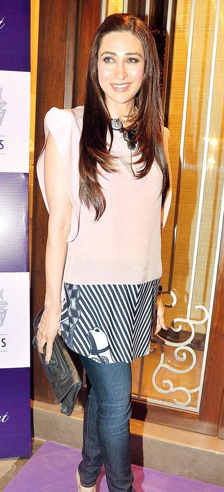 Karisma Kapoor Dons Pastel Shades At Pradeep Jethani's Jet Gems Store Launch