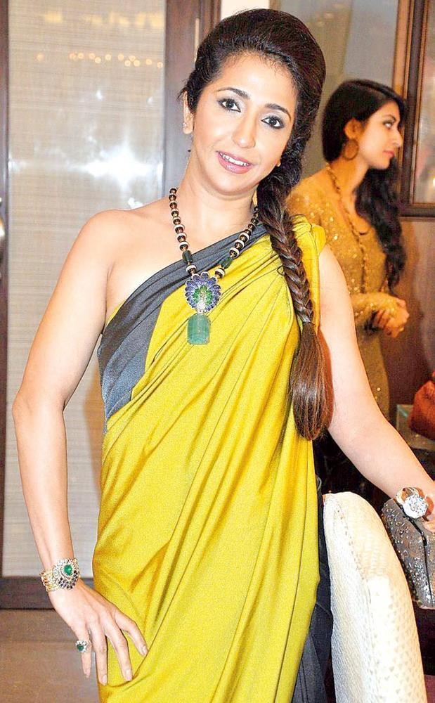 Krishika Lulla Sports An Interesting Hairstyle At Pradeep Jethani's Jet Gems Store Launch