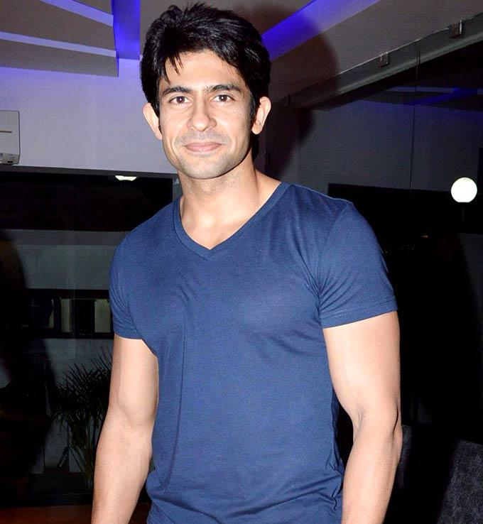 Hussain Kuwajerwala Pose For Camera In An Event