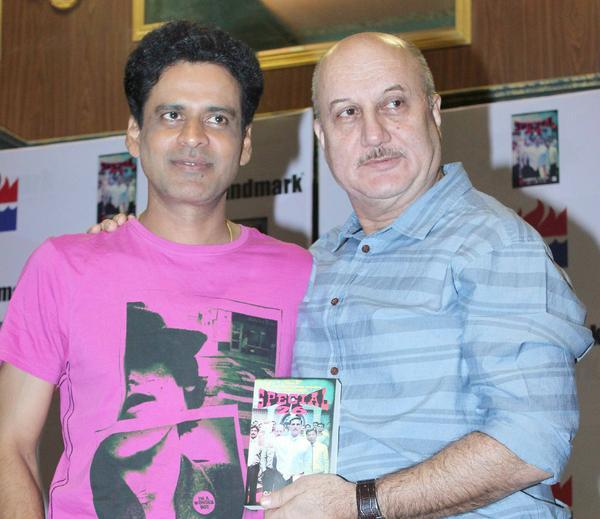 Manoj And Anupam Strike A Pose With Book At Special 26 Book Launch
