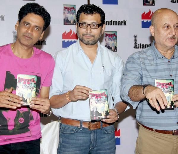 Manoj,Neeraj And Anupam Show The Special 26 Book To The Camera