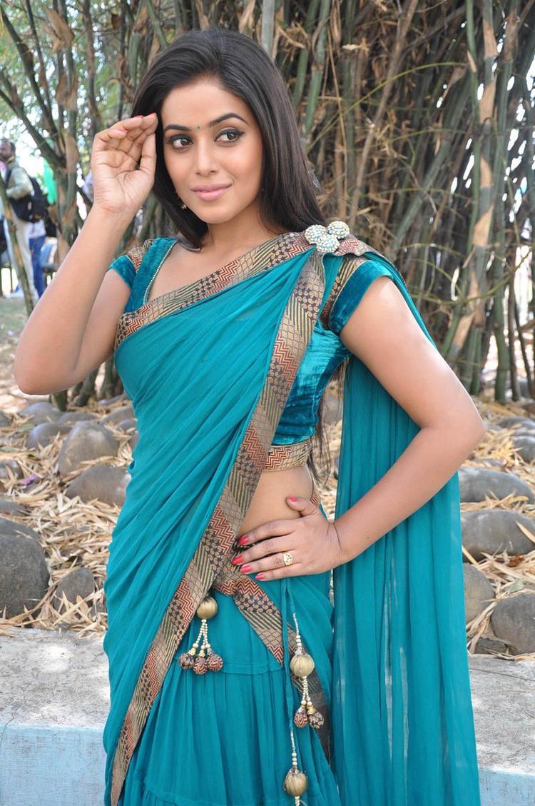 Poorna In Saree Nice Pose At Telugulo Naaku Nachani Padam Prema Movie Opening Event