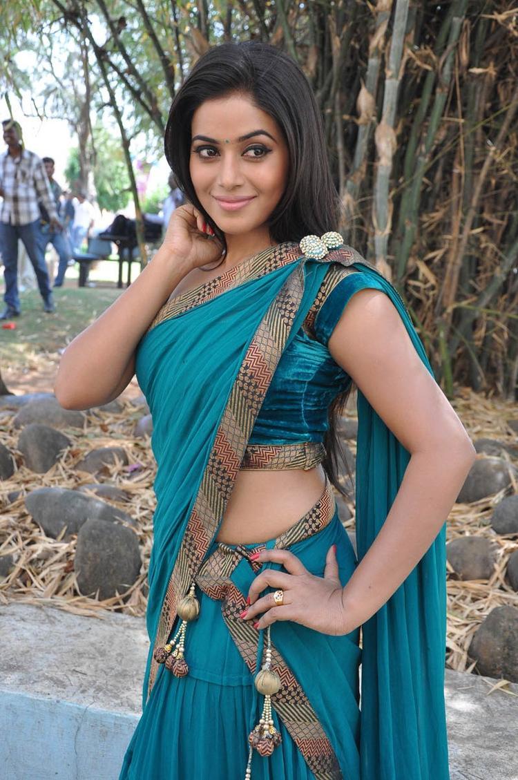 Poorna In Saree Smiling Look At Telugulo Naaku Nachani Padam Prema Movie Opening Event