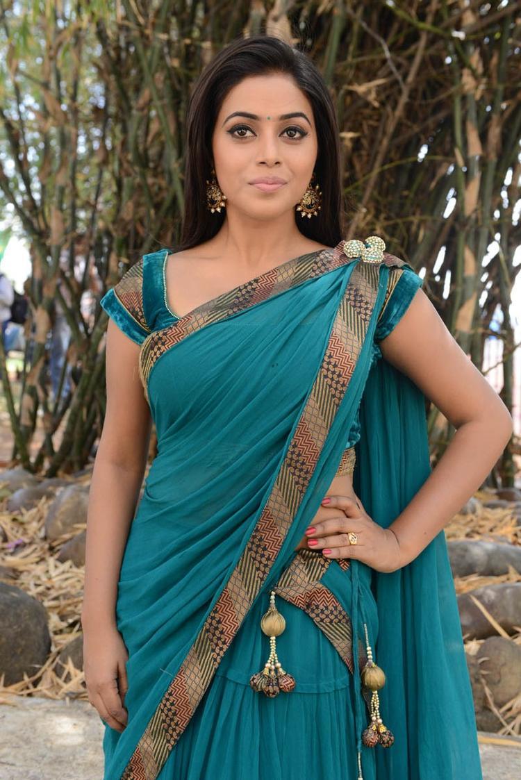 Poorna In Saree Strikes A Pose At Telugulo Naaku Nachani Padam Prema Movie Opening Event