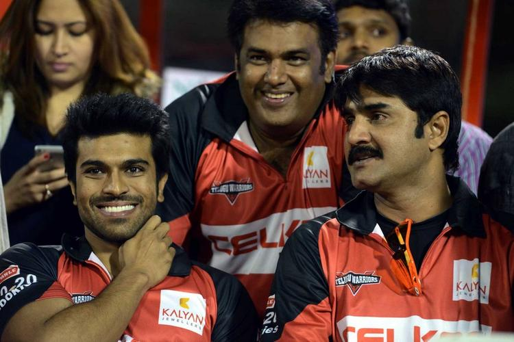 Ram Charan And Srikanth Smiling Photo Clicked At CCL 3 Telugu Warriors Vs Mumbai Heroes Match