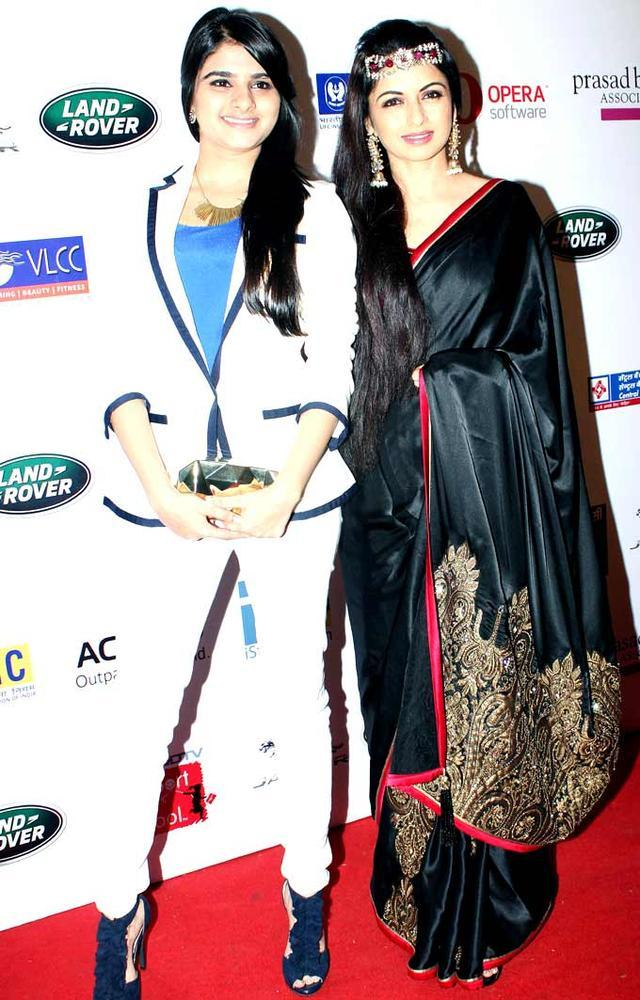 Bhagyashree With A Friend Walk On Ramp At The Smiles Foundation Fashion Show