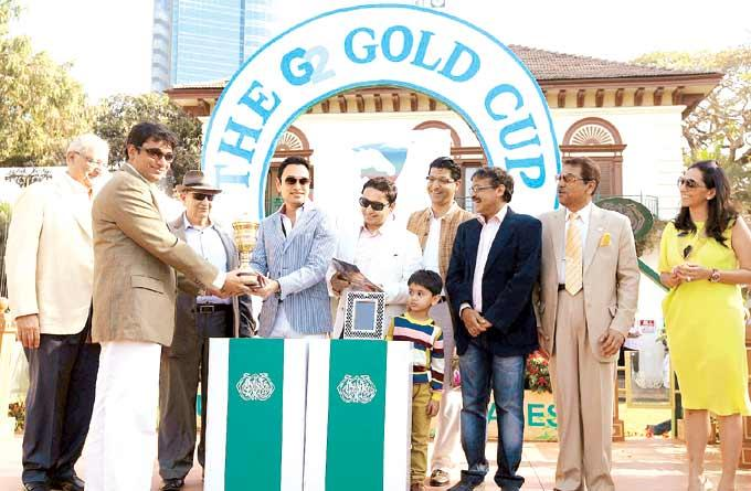 Devendra And Rishi Give Away The G2 Cup At The G2 Gold Cup Race Event