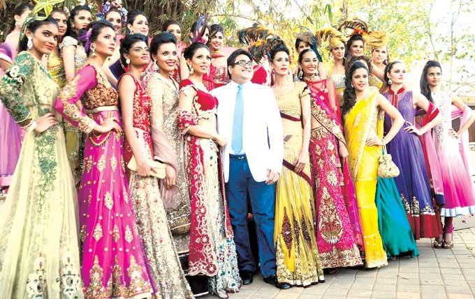 Pradeep Of Kimaya Poses With Models At The Fashion Show