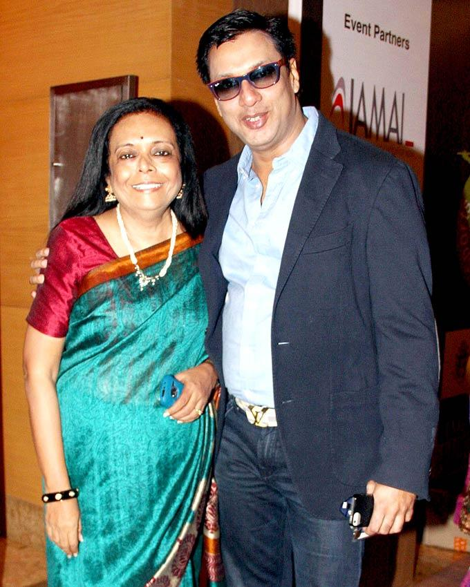 Madhur With A Friend Pose For Camera At IMC Fusion 2013 Awards