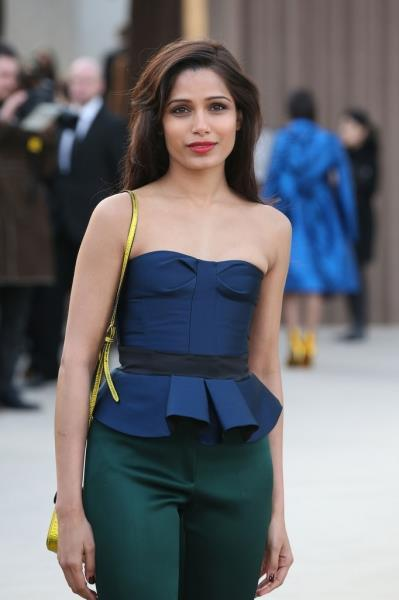 Freida Pi Strikes A Pose At Burberry Fashion Show