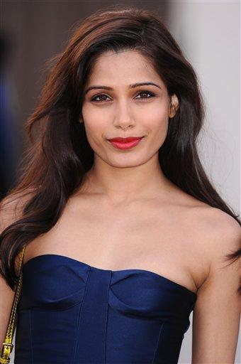 Freida Pinto Cute Smiling Photo Clicked At Burberry Fashion Show