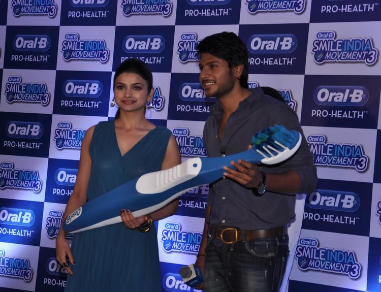 Prachi And Sundeep Smiling Pose During At Power Of Healthy Smile Event