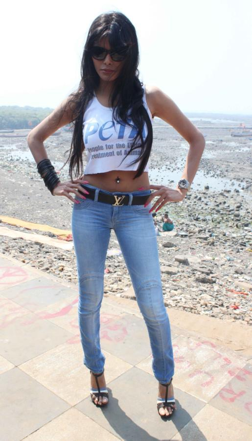 Sherlyn Chopra Sexy Pose At Promotion Of PETA's Safe Sex For Animals Campaign