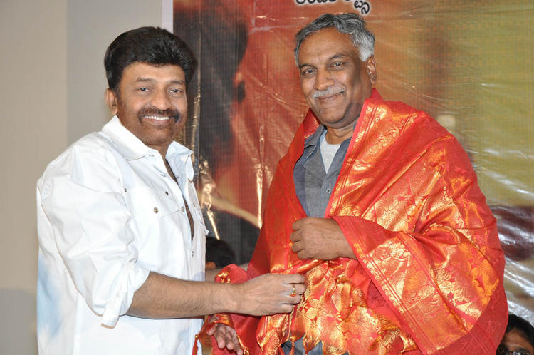 Rajasekhar With A Guest Posed For Camera At Mahankali Movie Trailer Launch