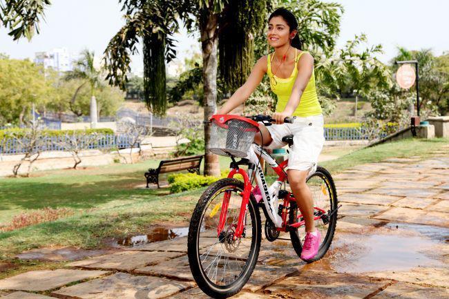 Shriya Saran Cycle Riding Photo Still From Movie Pavitra